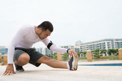 Performing stretching exercise Stock Images
