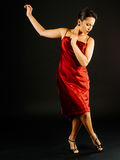 Performing tango dance moves. Photo of a young beautiful woman performing tango moves Stock Image