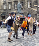 A performing troupe at the Edinburgh Fringe Festival handing out fliers on the Royal Mile Royalty Free Stock Photo