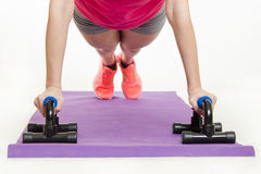 She performs the bench press with help of stops Stock Photo