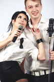 Performs duet singing microphone Stock Photography