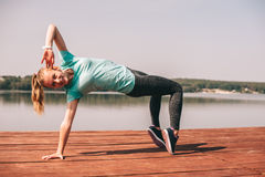 She performs exercises on pier royalty free stock images
