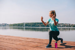 She performs exercises on pier Royalty Free Stock Image