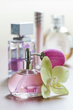 Perfume. Bottle with flower close up shoot Stock Image