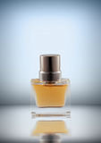 Perfume. Transparent bottle of perfume with reflection royalty free stock image