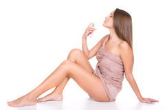 Perfume. Young beautiful woman with bottle of perfume Royalty Free Stock Photos
