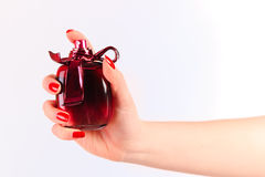 Perfume. Woman holding in her hand perfume Stock Photo