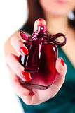 Perfume. Woman holding in her hand perfume Royalty Free Stock Image