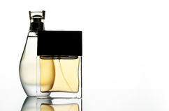Perfume. Two perfume bottles on a whute backdrop Royalty Free Stock Photography