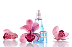 Perfume. Orchid Flowers with Perfume Bottle Royalty Free Stock Image
