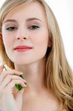 Perfume. Young blond woman with perfume royalty free stock images