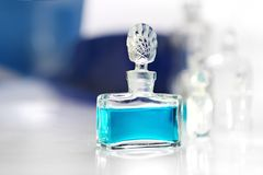 Perfume. On a white table Royalty Free Stock Image