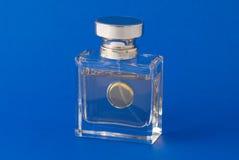 Perfume. Bottle on the blue background Stock Photography