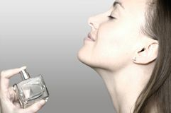 Perfume. Beautiful woman and bottle  of perfume's water Stock Photography