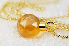 Perfume and beads Royalty Free Stock Image