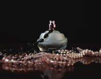 Perfume and beads Stock Photos