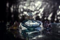 Perfume in beautiful blue bottle Stock Image