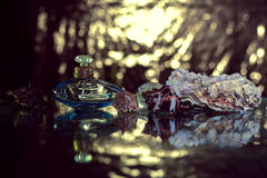 Perfume in beautiful blue bottle Royalty Free Stock Images