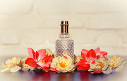 Perfume in beautiful bottle and flower Royalty Free Stock Photography