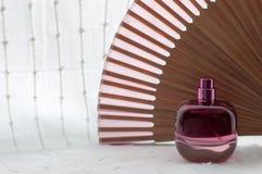 Perfume. Beautiful perfume pink in bottle Stock Image
