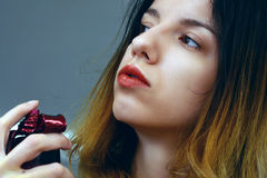Perfume beauty. A woman using a sweet perfume on her neck Royalty Free Stock Images