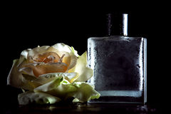 Perfume with a big flower Royalty Free Stock Images