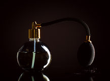 Perfume on a black background Royalty Free Stock Images