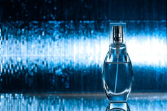 Perfume on blue background Royalty Free Stock Photo