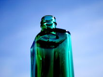 Perfume bottle. In the background of the sky, a bit artistical toned. Focus on the top Stock Photography