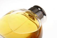 Perfume bottle. A bottle of top-grade perfume lying on white background Stock Image