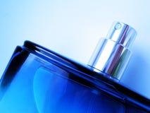 Perfume bottle. Cologne/perfume bottle against blue background Royalty Free Stock Photo