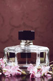 Perfume bottle. With pink flowers Stock Photography