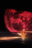Perfume bottle. With a moonlight background Royalty Free Stock Photos