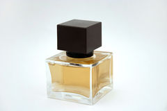 Perfume bottle. A square perfume bottle with brown cap Stock Photography