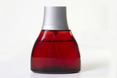 Perfume bottle. Red brown glass perfume bottle Stock Photography