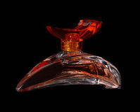 A perfume bottle. On the black background Royalty Free Stock Photos