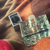 Perfume bottle. On a fabric  background Stock Images