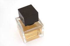 Perfume bottle. A square perfume bottle with brown cap Royalty Free Stock Images
