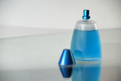 Perfume Bottle. A perfume bottle on a desk Royalty Free Stock Images