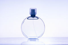 Perfume bottle. On the table Royalty Free Stock Photo