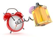Perfume bottle with alarm clock Royalty Free Stock Photo