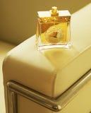 Perfume Bottle on Armchair Stock Photography