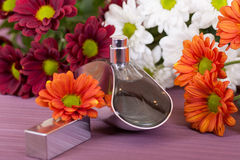Perfume bottle  Background decorated with flowers. Horizontal shot Stock Photography