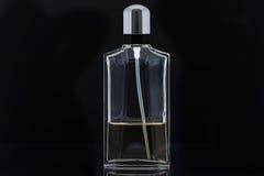 Perfume. Bottle on black background Stock Photo