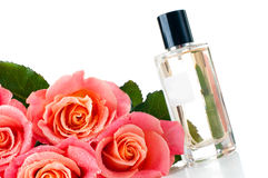 Perfume bottle and a bouquet Stock Images