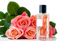 Perfume bottle and a bouquet Stock Photos