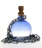 Perfume bottle and chain Stock Photo