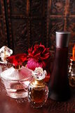 Perfume bottle collection. Selection of crystal and other perfume bottles in romantic setting. Copy space on top royalty free stock images