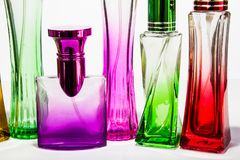 Perfume bottle Colorful White background Royalty Free Stock Images