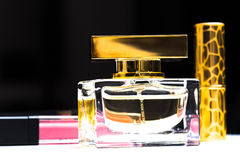 Perfume bottle and cosmetics Stock Photography